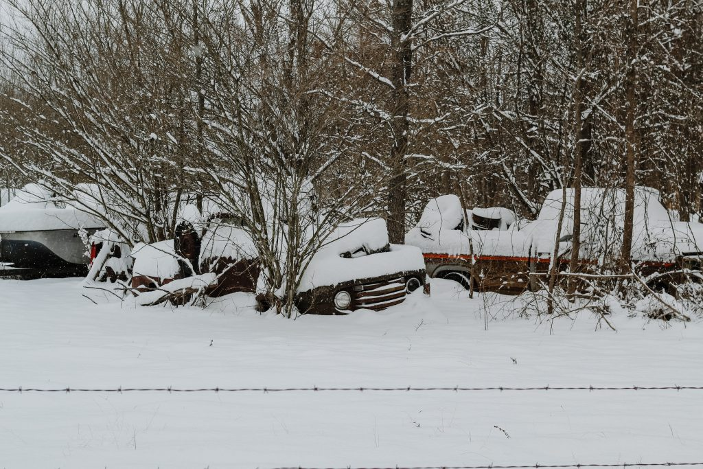 snow on abandoned vehicles